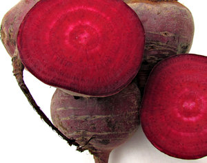 beetroot: raw uncooked beetroot showing cut halves