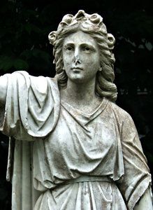 Grecian reflection: Grecian style graveside statue