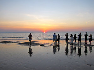 sunset reflections: reflections of tourist photographers snapping the sunset