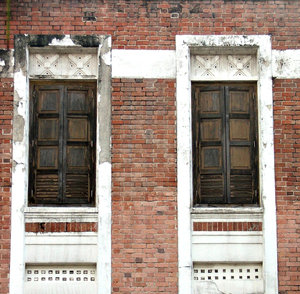 old & neglected: neglected second storey traditional Chinese door/window shutters