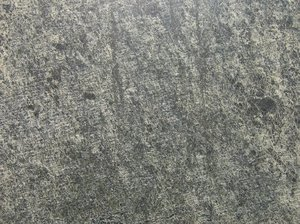 grained black rock texture