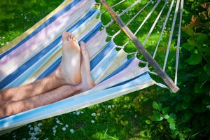 Summer feeling: A man sleeping in a hammock. Feeling good.