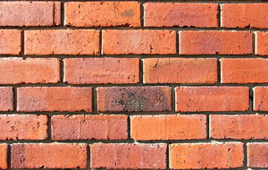 up against a brick wall