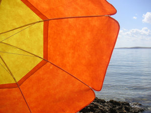 Beach time 1: Orange and yellow sun umbrella