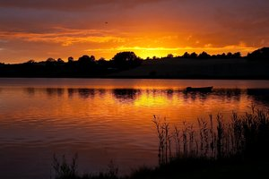 Danish sunset: Sunset over a small lake in Jutland, Denmark.