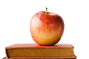 Apple on books: apple on a pile of books