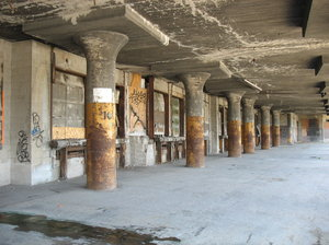 decaying loading dock: a forgotten and decaying loading dock beneath the railroad tracks