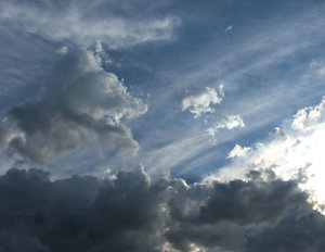 cloud contrast: several cloud layers with dark clouds and sunlight breaking through