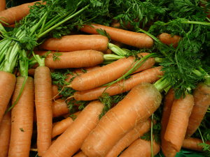Carrots: carrots in a market stall