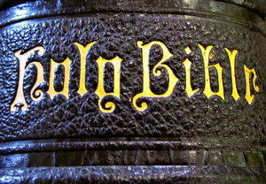 old black Bible spine: gold lettering on old historic black Bible spine