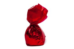 Bonbon: Chocolate bonbon in red wrapper.