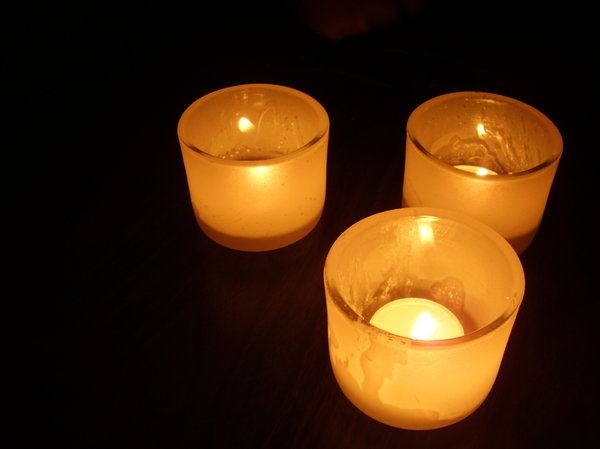 Candles in dark: Close ups of candles in glasses at night