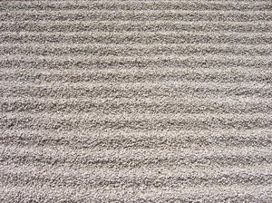 gravel stone ripples texture: the raked gravel stone ripples represent flowing water in an japanese garden