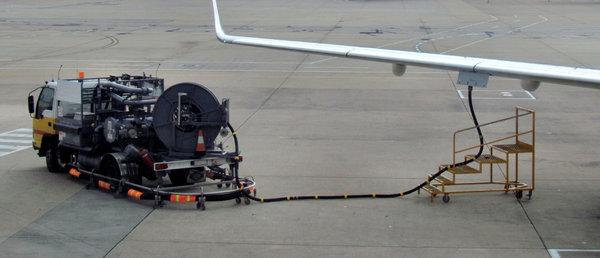 airport refuelling: fuel pumped into wing storage tanks