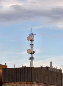 rooftop communications tower: communications tower atop city commercial highrise