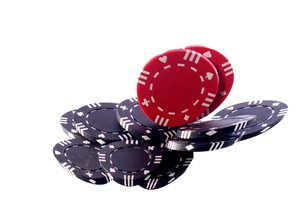 Poker chips falling: Red poker chips falling on black poker chips. The image is slightly disorted. Isolated with white background.