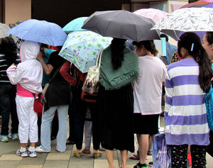 queuing in the rain