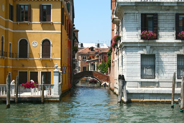 Venice canal: A side-canal and pedestrian bridge in Venice.