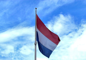 flag flying high1: Dutch flag flying high on flagpole
