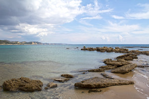 Coastline with fisherman: Rocky coastline of northern Cyprus with opportunistic fisherman.