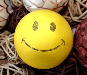 fading smile2: worn yellow smiley face rubber ball