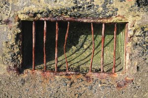 Escape?: Bent rusty iron bars