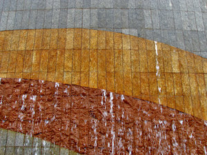 wet wall textures2: water cascading down coloured and textured wall feature
