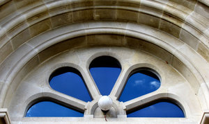 arched petals window1B: arched window in historic city building