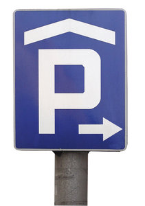 Parking lot under the roof: A parking sign.