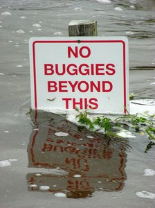 Sign under water: Summer floods in Scotland on golf course