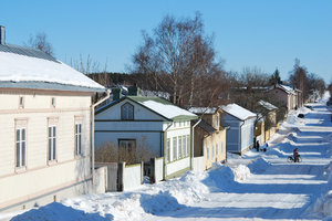 Spring Shadows: Wooden houses and shadows on the street of small finnish city