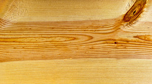 Pine Wood Grain Texture: A section of a pine board with a couple of knots and wood grain texture.