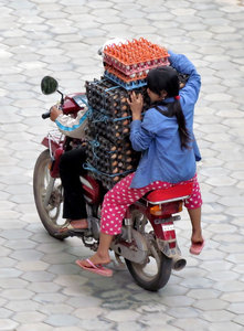 egg-spress delivery: balancing act delivering fresh eggs to hotel in Cambodia