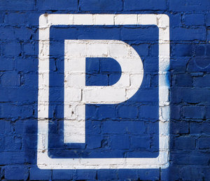 blue wall parking: parking area sign on blue wall