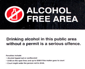 not here: sign prohibiting the consumption of alcohol in a public place