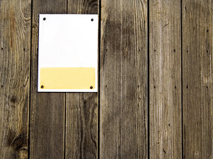 Blank Sign: Blank sign on wooden fence/wall.  Lots of copy space.