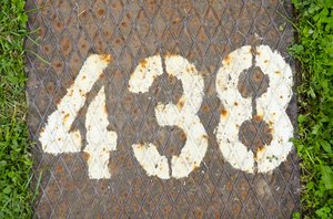 438 painted numbers: 438 painted numbers found on a camping place - texture