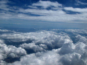 above and below3: clouds seen through plane window during flight