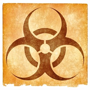Biohazard Grunge Sign: Grunge textured biohazard symbol on vintage paper, with sepia toning for a more aged feel.