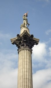 Nelson's Column: The statue of Nelson on his column in Trafalgar Square, London, with hat decorated for the 2012 Olympics festivities.