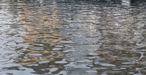 Ripples and reflections: Ripples and reflections of water in a quay in Denmark.
