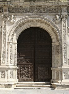 Ancient carved door: An ancient door in Seville, Spain.