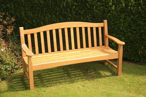 Wooden Bench: Wooden bench in garden setting