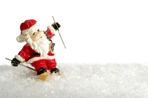 Santa skiing: Santa claus skiing in snow