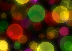 Bokeh or Blurred Lights 8: Bokeh, or blurred background lights in green, yellow, red, purple and black. Suitable for a background, Christmas greetings, holiday greetings, texture, or fill.