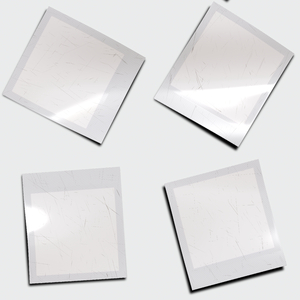 Photo Frame 4: 4 blank Polaroid-style photo frames in a neutral colour with a scratched surface.. Hi-res image. You may prefer this:  http://www.rgbstock.com/photo/nHORIpQ/Polaroid+Frame