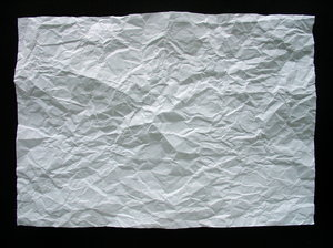 Creased paper: A creased or crumpled flat sheet of paper