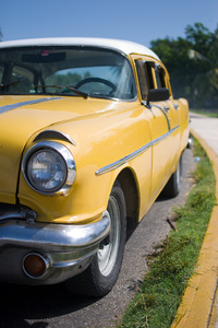 Yellow Cuban classic car 2