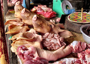 local market14: pigs' heads and pork at local Cambodian general market