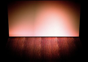 Stage Backdrop 6: A wall and floor with lighting effects that could be a stage, shelf or empty room. You may prefer this:  http://www.rgbstock.com/photo/nWlZB9c/Stage+Backdrop+5